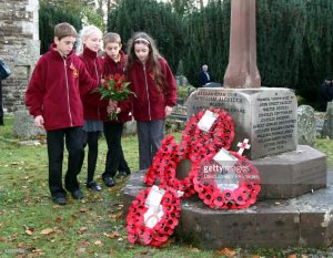 school children with their poppies
