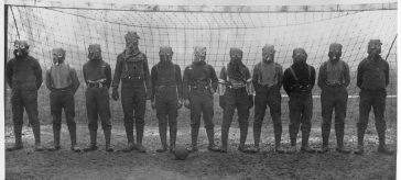 British Soldiers playing football in gas masks in 1916