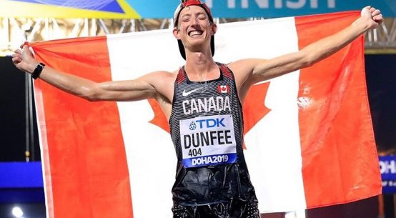 Evan Dunfee after crossing the line in Doha to win the bronze medal. Photo credit: Andy Lyons/IAAF