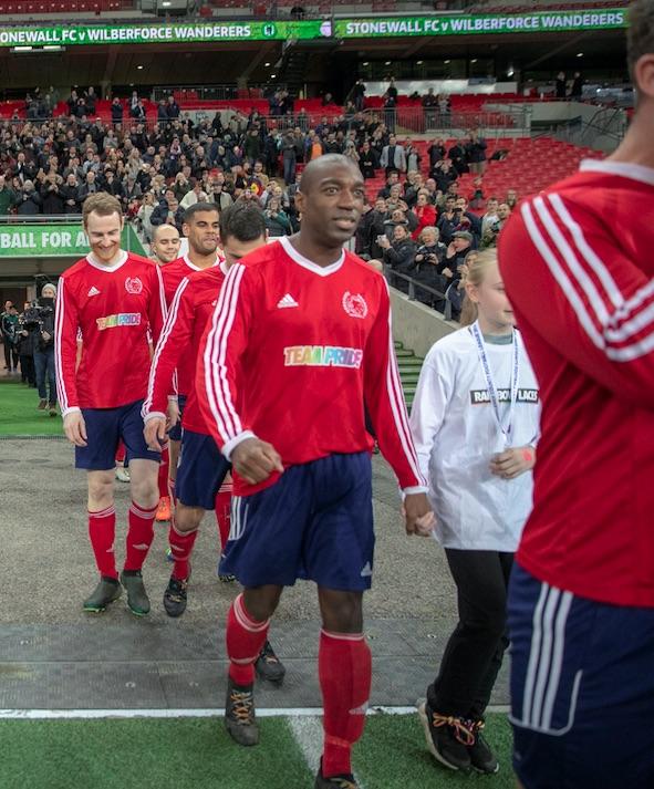 Lemonius walks out with Stonewall FC at Wembley. Photo courtesy of Jay Lemonius