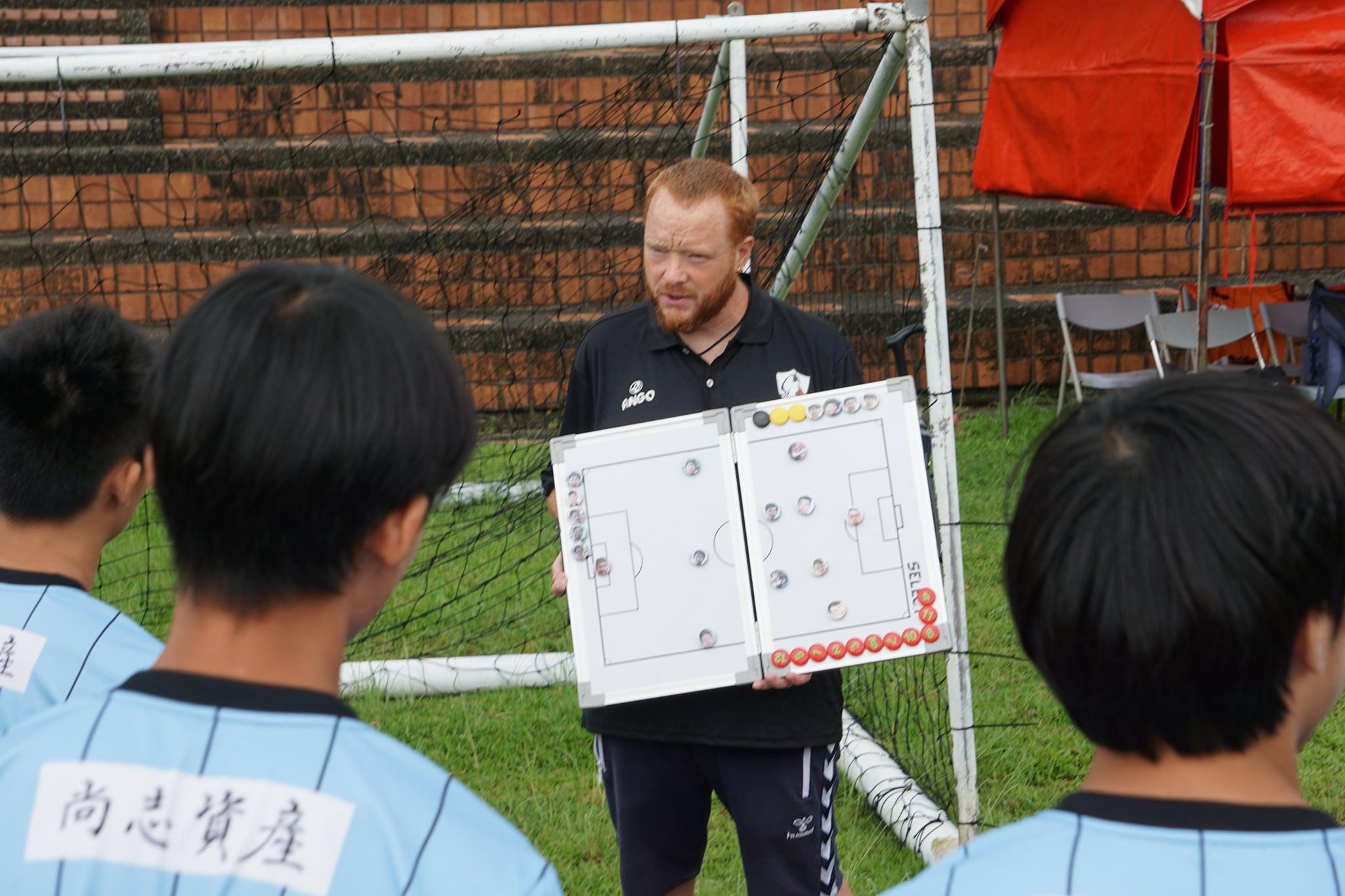 Taiwan-based Danish football coach Johnni Nielsen runs his FC Vikings team through some tactics.
