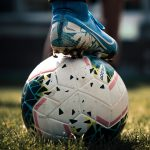 A stock image of a footballer resting his foot on a ball.