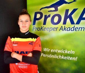 ProKA and SV Alberweilergoalkeeper Damai Bock poses in front of a ProKA backdrop.