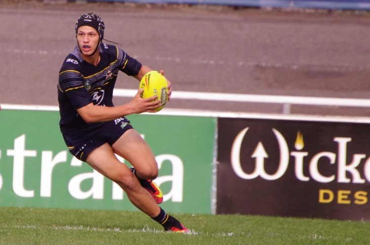 Ruby league player Kalyn Ponga runs with ball in hand.