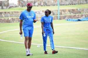 Courtney Walsh in discussion with Women's Cricket Captain Stafanie Taylor