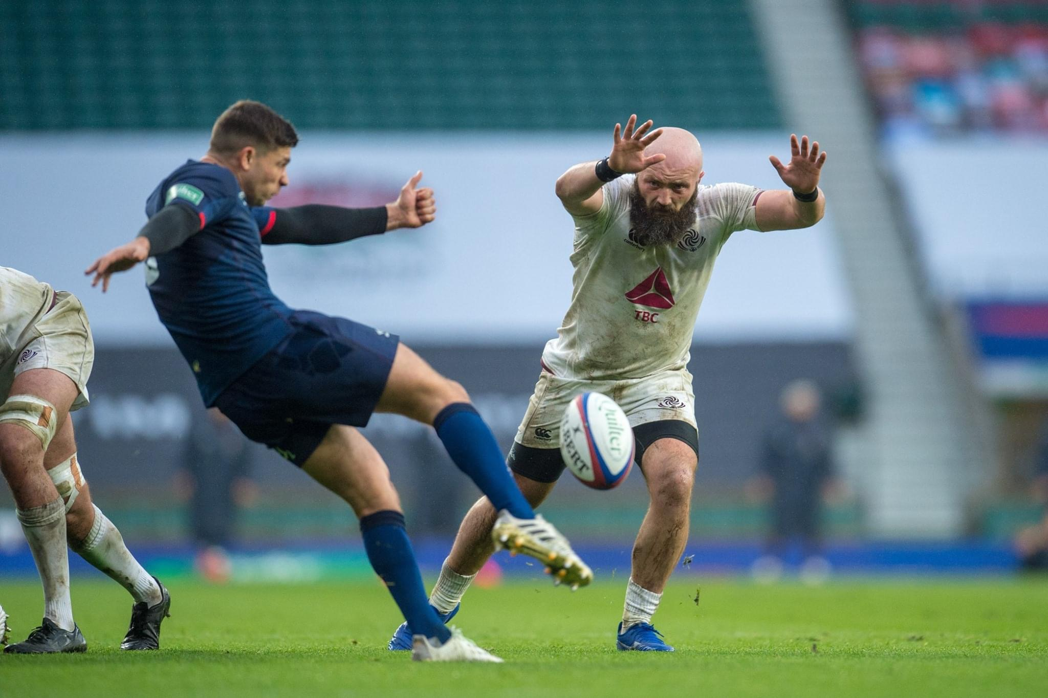 Georgia Rugby player Shalva Mamukashvili charges down England's Ben Youngs