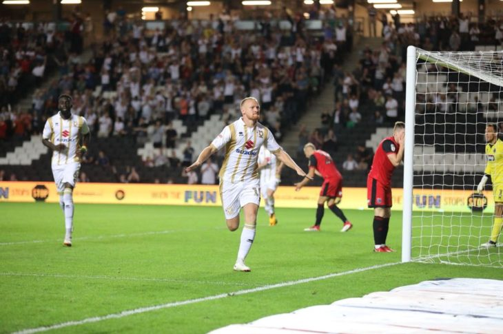 Robbie Simpson scoring for MK Dons