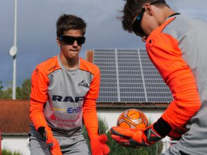 Two young goalkeepers at ProKA conduct a training drill.