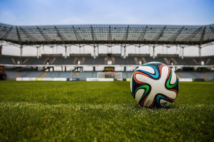 Can Euro 2021 really be held across multiple European countries? Image - a football placed as though for a goal kick in an empty stadium