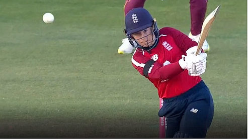 Tammy Beaumont, star of the ongoing New Zealand v England series, hits a straight drive.